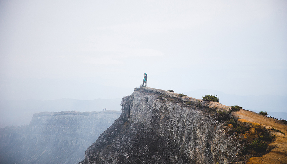 Adventurer on cliff
